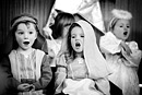 Children sing in their nursery nativity play, black and white image