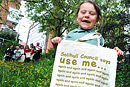 A girl holding a Solihull Council bag takes part in a clean up campaign