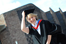 A happy graduate outside Coventry Cathedral