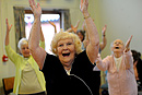 Residents of an old peoples home take part in an exercise class