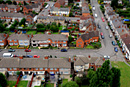 A tilt shift image of residential homes taken from a block of flats
