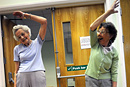 Elderly residents take part in a keep fit class