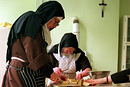 Nuns preparing a meal