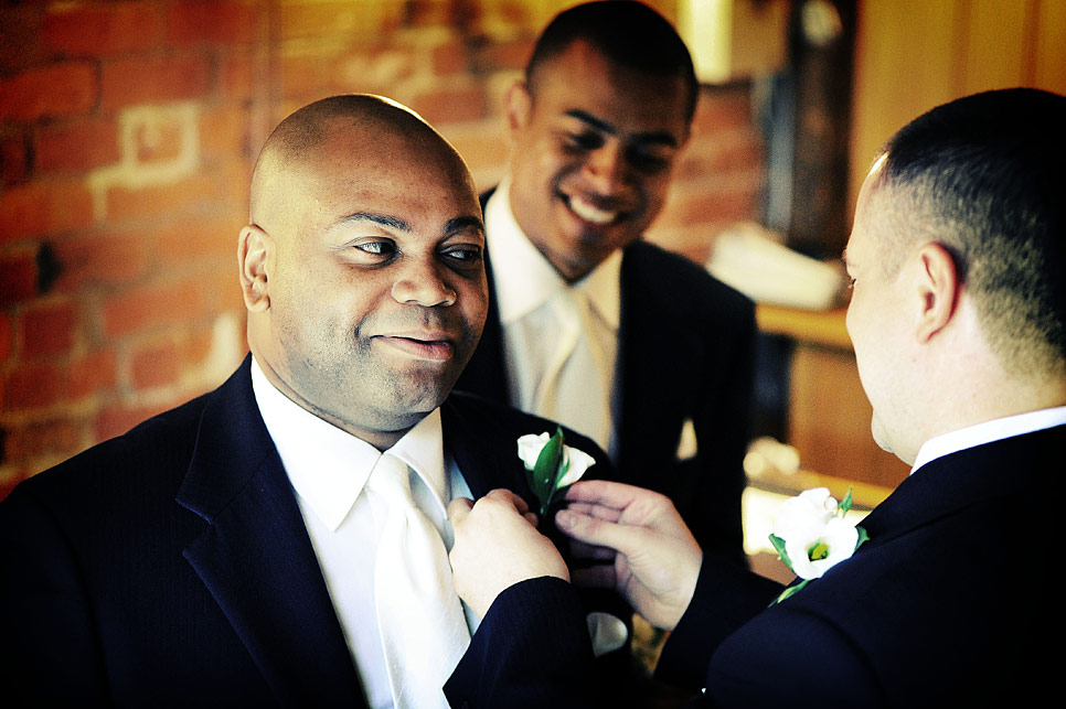 The groom adjusting a buttonhole